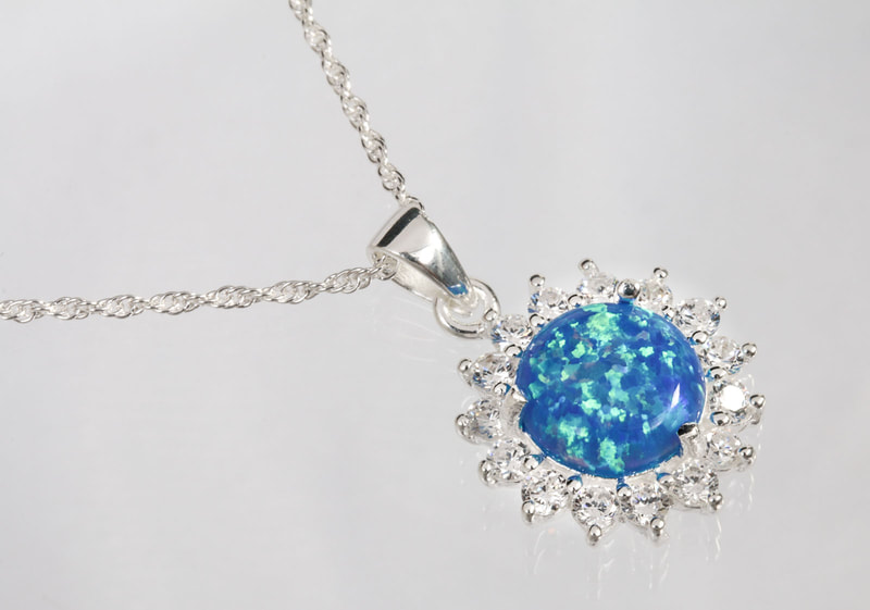 Jewelry Photography silver necklace with precious stones