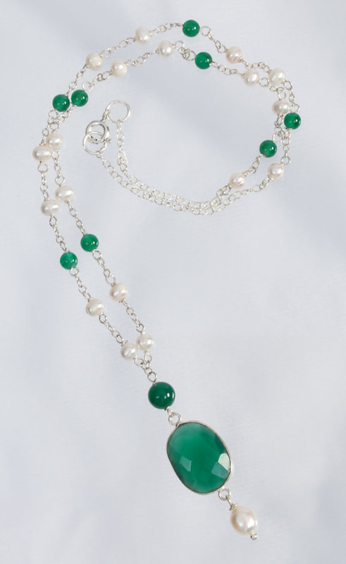 Jewelry Photography silver, pearl and precious stone necklace